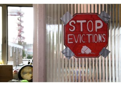 "Stop Evictions / Lisa Furness / C-type digital print / £15-25 (<a href=""https://www.prscshop.co.uk/products/stop-evictions"" target=""_blank"" rel=""noopener noreferrer"">buy</a>)"